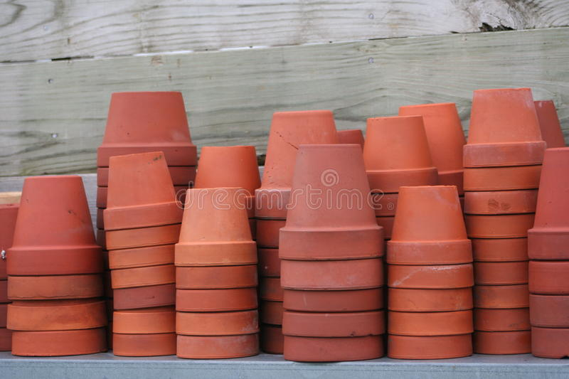 Terra cotta flower pots. Used vintage terra cotta flower pots some with expansion cracks and imperfections, natural color natural light unedited image royalty free stock photography