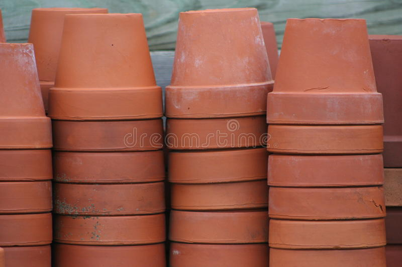 Terra cotta flower pots. Used vintage terra cotta flower pots some with expansion cracks and imperfections, natural color natural light unedited image royalty free stock images