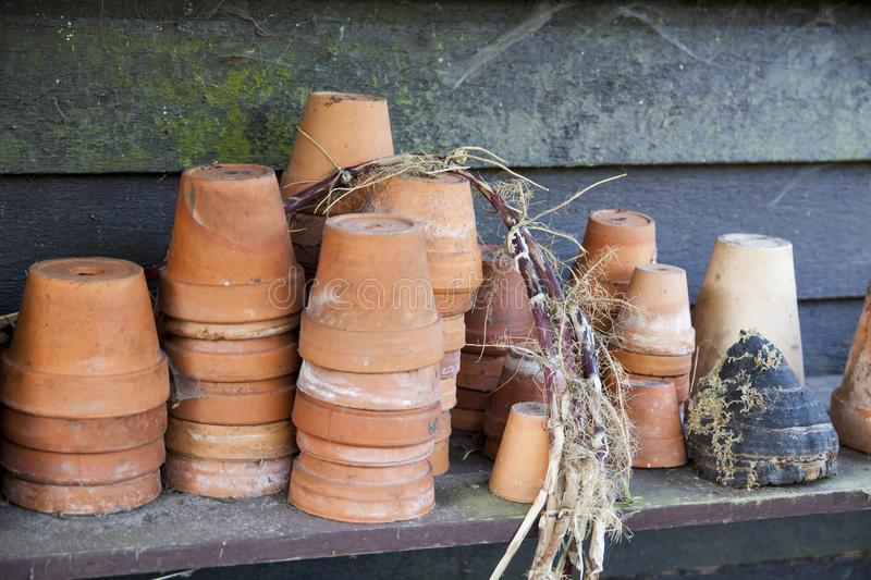 Terra cotta. Old terra cotta pots on a wooden background stock images