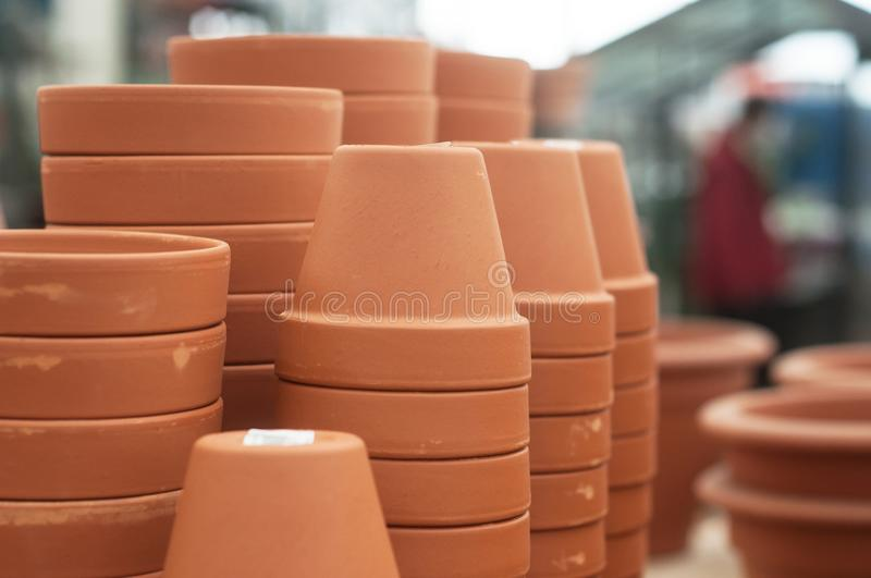 Terra cotta pots pile in a green house. Closeup of terra cotta pots pile in a green house royalty free stock image