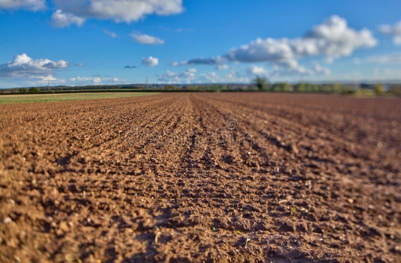 Terra de exploração agrícola imagens de stock