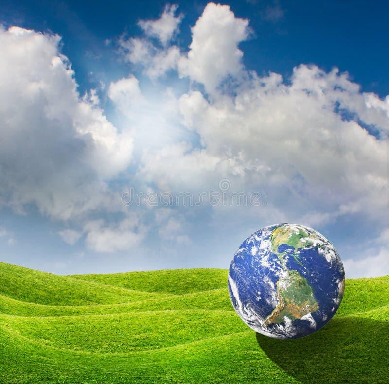 Terra del pianeta su un prato verde illustrazione vettoriale