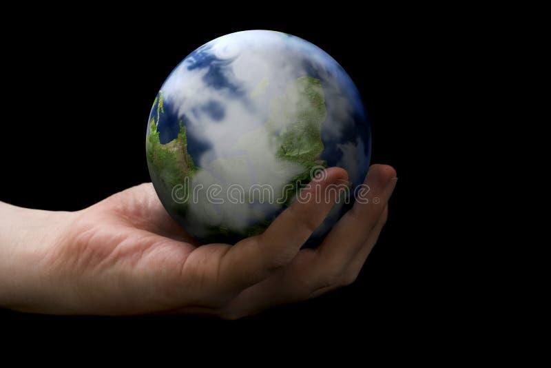 Terra della holding della mano fotografie stock