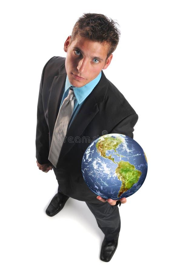 Terra do planeta da terra arrendada do homem de negócios foto de stock