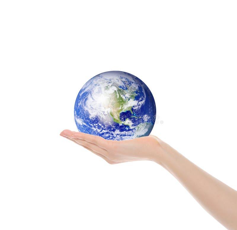 Terra do planeta na mão fêmea imagens de stock royalty free