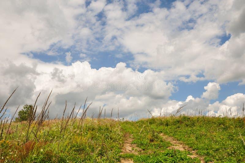 Terra e céu imagem de stock