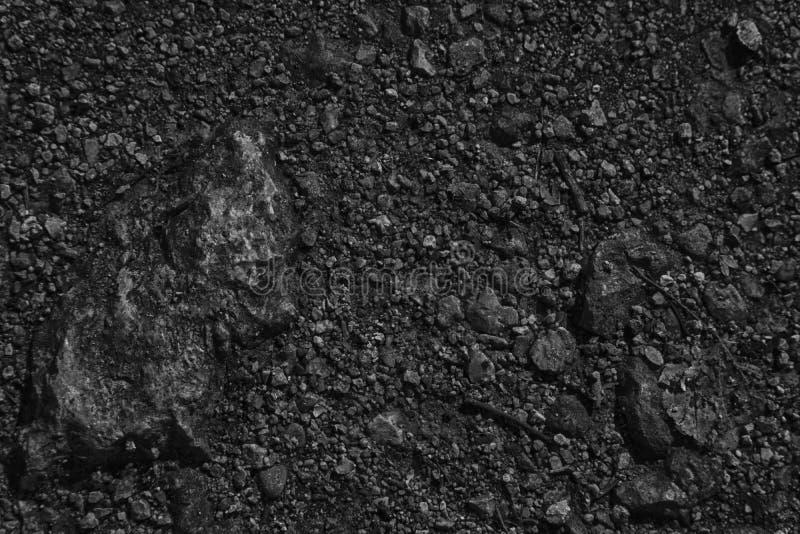A terra monocromática gosta em Marte, textura da terra, superfície da areia, fundo de pedra imagem de stock royalty free