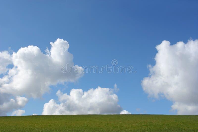 Terra, nubi e cielo fotografia stock