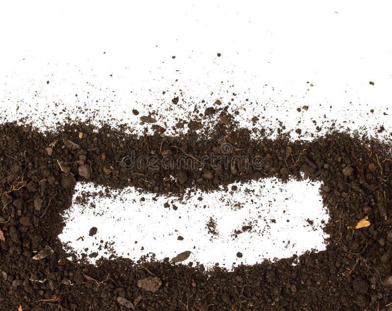 Terra suja no fundo branco fotografia de stock