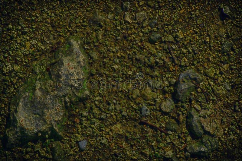 A terra ultra alaranjada gosta em Marte, textura da terra, superfície da areia, fundo de pedra foto de stock royalty free