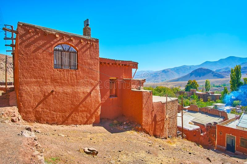The terrace adobe houses on the mountain slope of Abyaneh village. With the Karkas mountains on background, Iran royalty free stock images