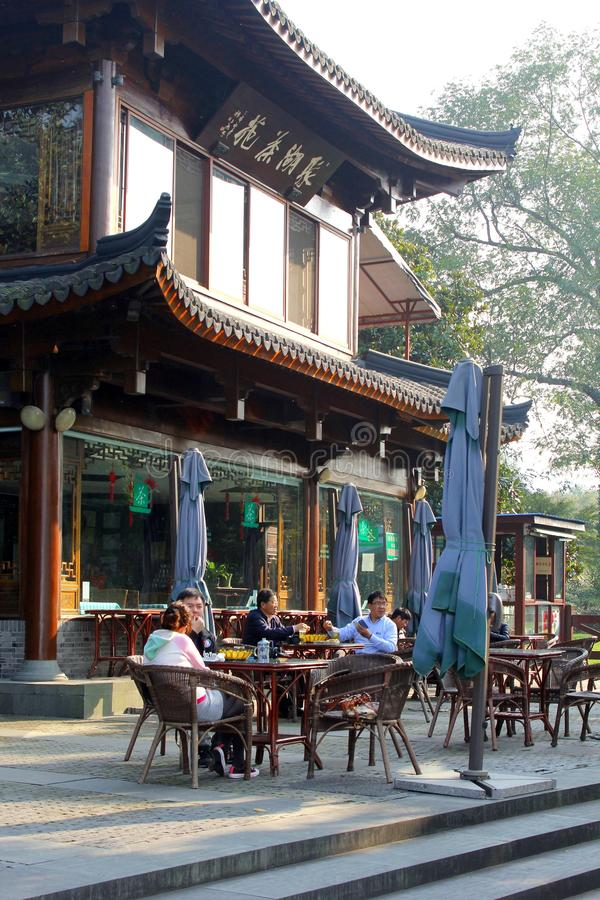 People enjoy their beverages at a cosy terrace along the West Lake (Unesco) in Hangzhou, China royalty free stock images