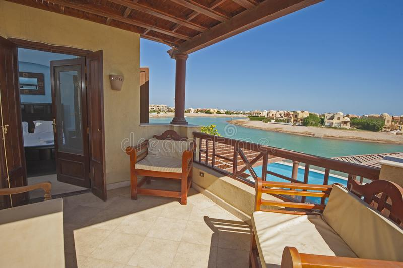 Terrace balcony from bedroom with chairs at tropical luxury villa royalty free stock image