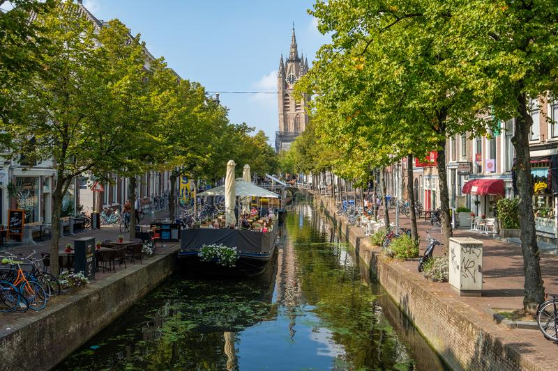 A terrace boat in a historic canal with a view of the leaning to royalty free stock image
