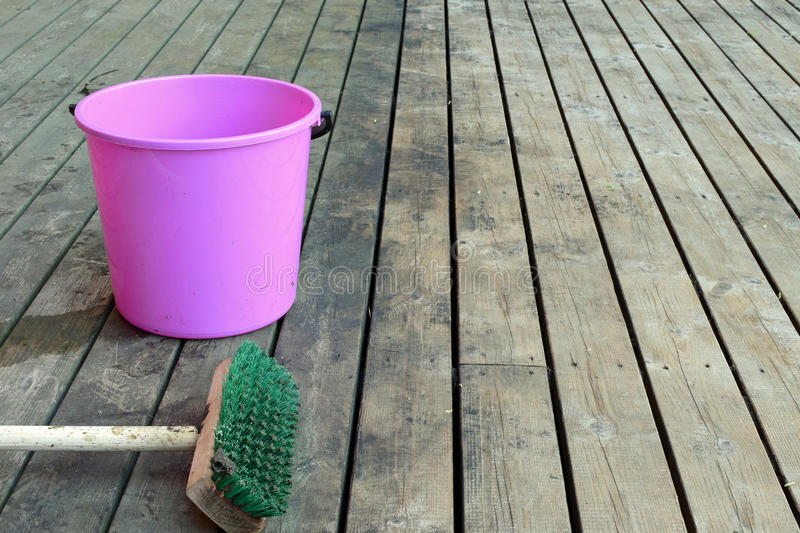 Terrace cleaning. Cleaning old dirty terrace. Before and after. Half is already clean and rest of the patio is still waiting for cleanliness royalty free stock images