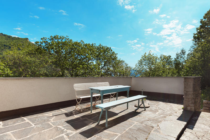 Terrace of a cottege, flooring stone stock photos