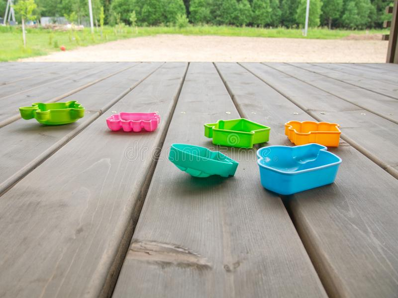 Terrace of a country house with children`s multi-colored toys. Horizontal orientation. Space for text royalty free stock photography