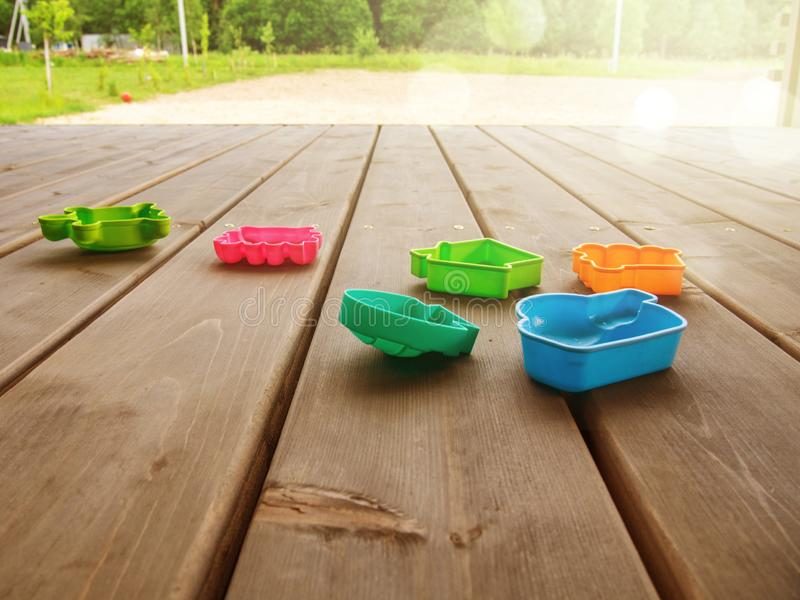 Terrace of a country house with children`s multi-colored toys on a sunny day. Horizontal orientation. Space for text stock image