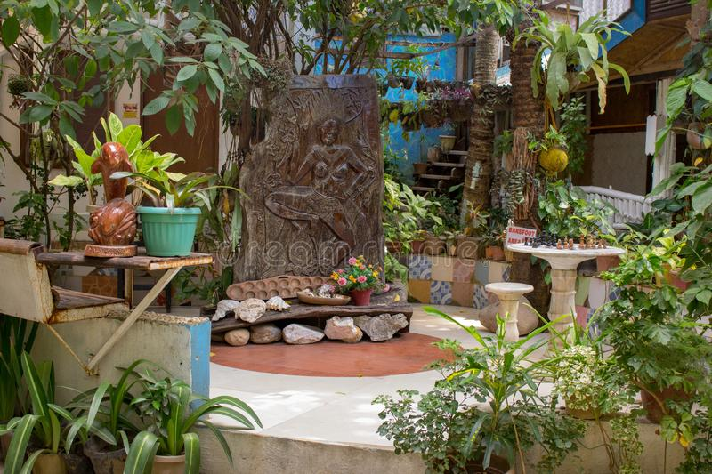 Terrace design in asian village, Philippines. Wooden decoration with plants and flower pots in tropical patio. Beautiful backyard. Gardering concept royalty free stock photo