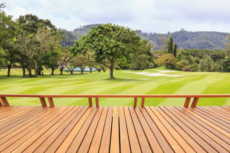 Hardwood decking or flooring and view of green field in golf course. Garden decorative royalty free stock images