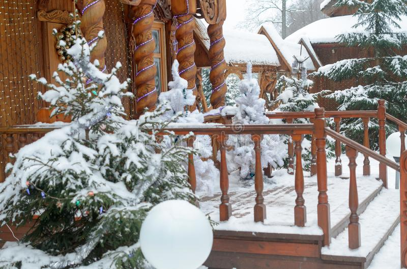 Terrace houses in the old Russian style in the winter with white firs. stock photo