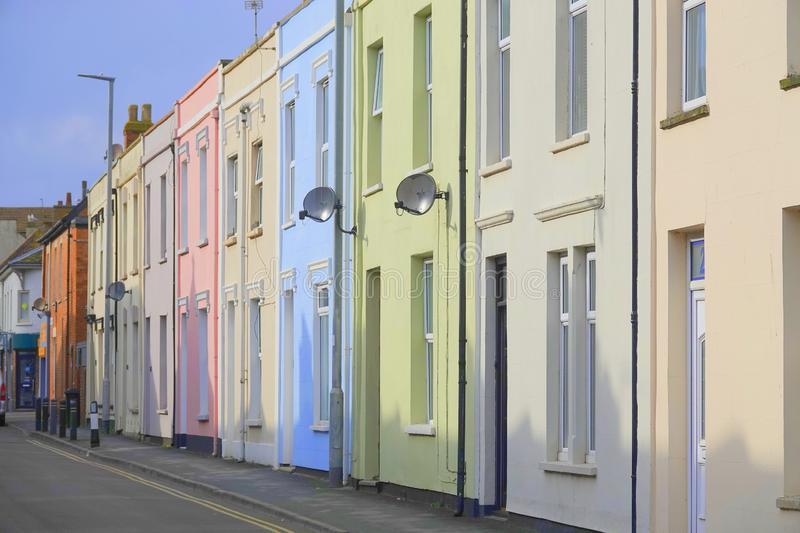 Terrace houses painted in pastel shades. Terrace houses painted in various pastel shades in an urban street in England stock photo