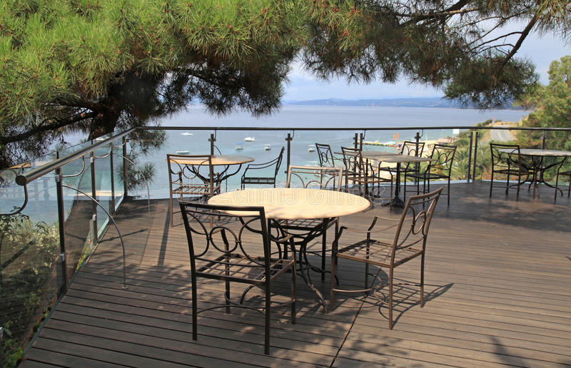 Terrace outdoor cafe and sea view in Greece. stock photography