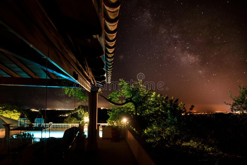 The terrace of the spanish house under starry night sky. The courtyard of the spanish house under starry night sky stock photo