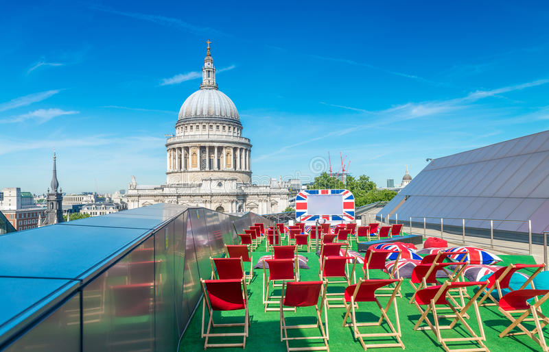 Terrace on St Paul Cathedral, red chairs against blue sky.  stock photo