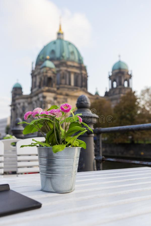 Terrace table with a flower pot and the Berlin Dome royalty free stock photography