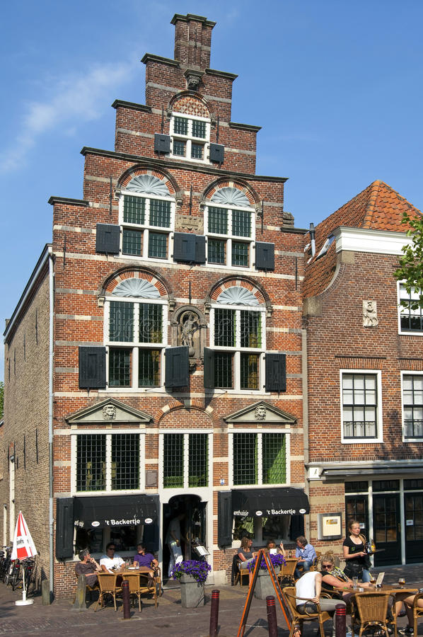 Terrace visitors for old Arminius House in Oudewater stock image
