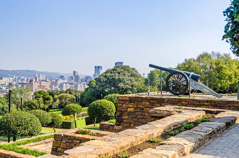 Terraced gardens of the Union Buildings with the historic naval gun and skyline of Pretoria royalty free stock photos