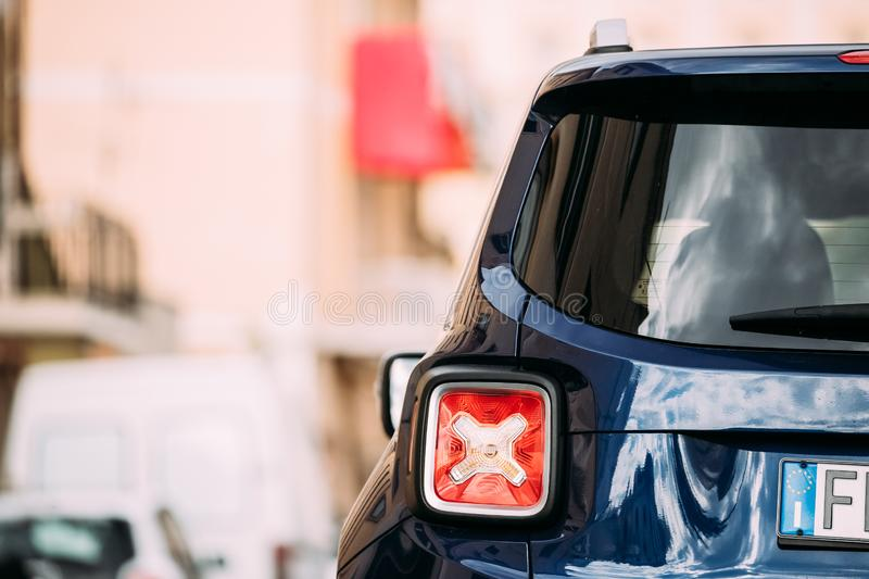 Terracina, Italy. Red Led Rear Lights Of Blue Jeep Renegade Bu 520 Car Parking At Street. Back View. Terracina, Italy - October 15, 2018: Red Led Rear Lights Of stock images