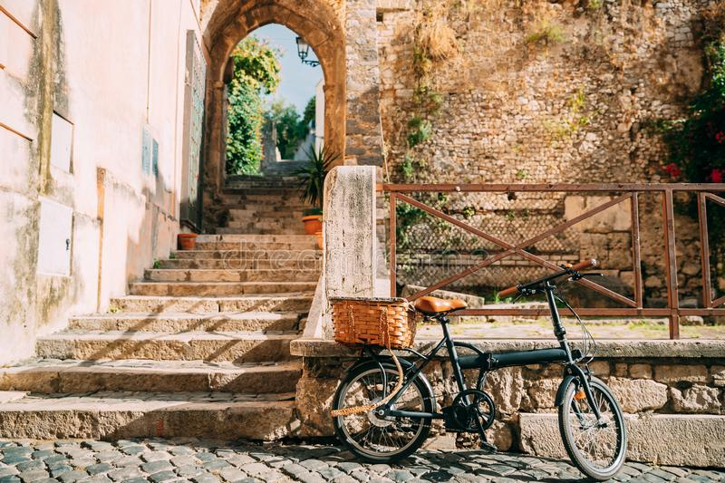 Terracina, Italy. Single Bicycle Bike With Basket Parking On Street Near Old Building.  royalty free stock photos