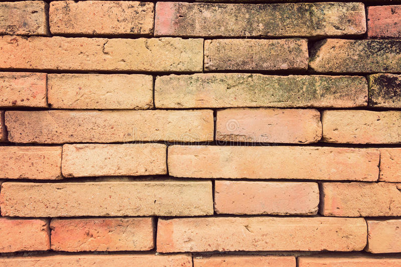 Terracotta brick wall in vintage retro color style. Straight on view of terracotta brick wall in vintage retro color style, good for using as background royalty free stock photography
