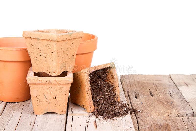 Terracotta or clay gardening pots with dirt spilling royalty free stock images