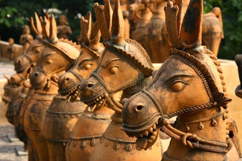 Terracotta clay unglazed ceramic horses royalty free stock photo