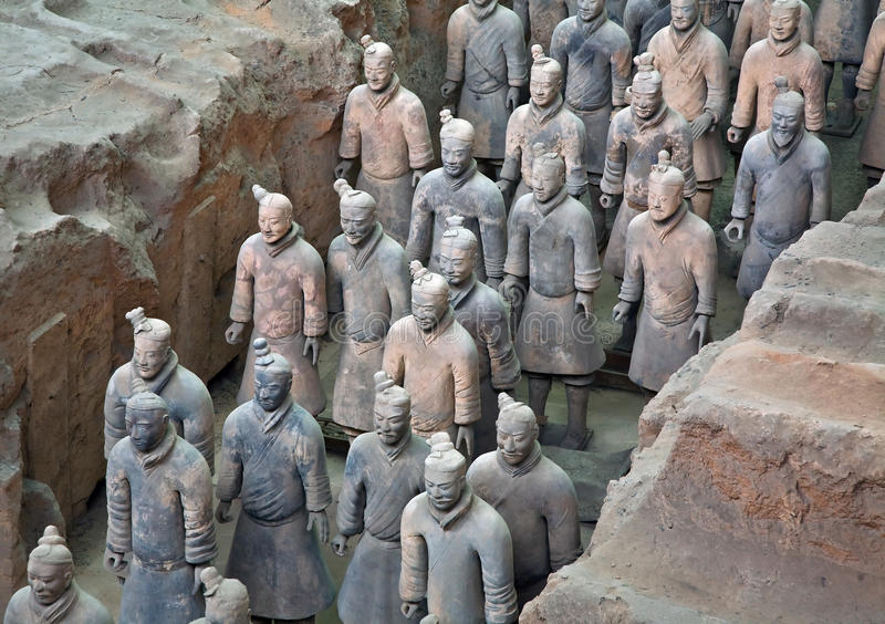 Terracotta Warriors. In formation displayed in a burial pit at the Terracotta Army Museum in Xian China stock image