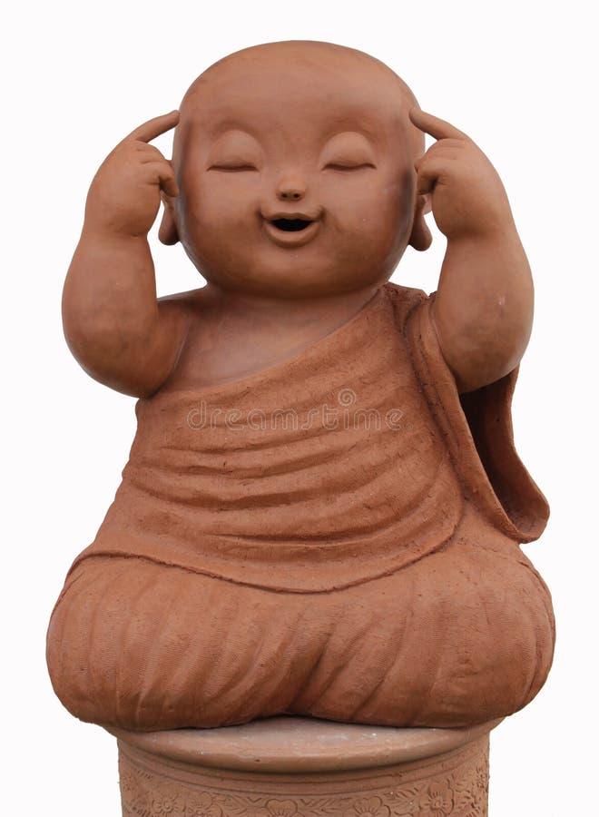 Terraglie del monaco del bambino isolate su fondo bianco fotografia stock