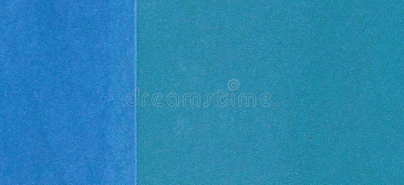 Terrain de jeu bleu ou fond en caoutchouc de grunge de couverture de miette d'au sol de sports photographie stock