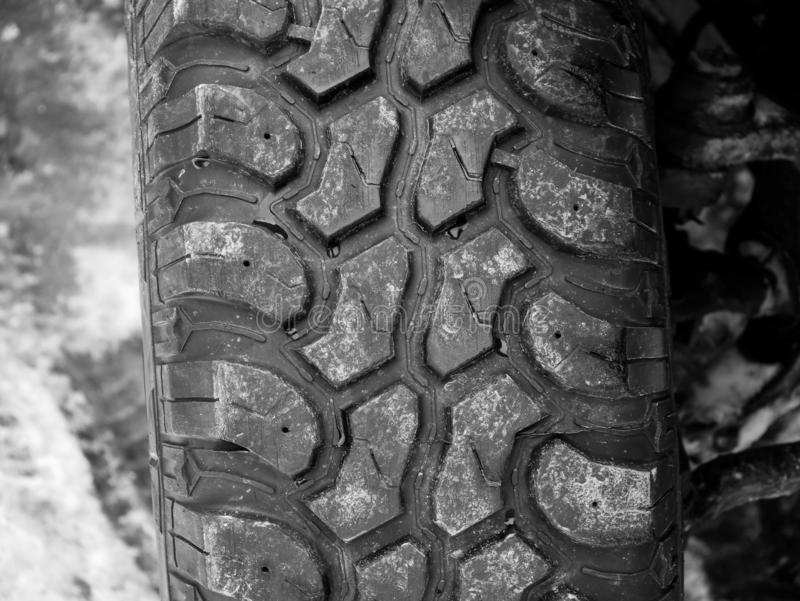 Terrain tyre close up shot on offroad vehicle. At roadside stock photos