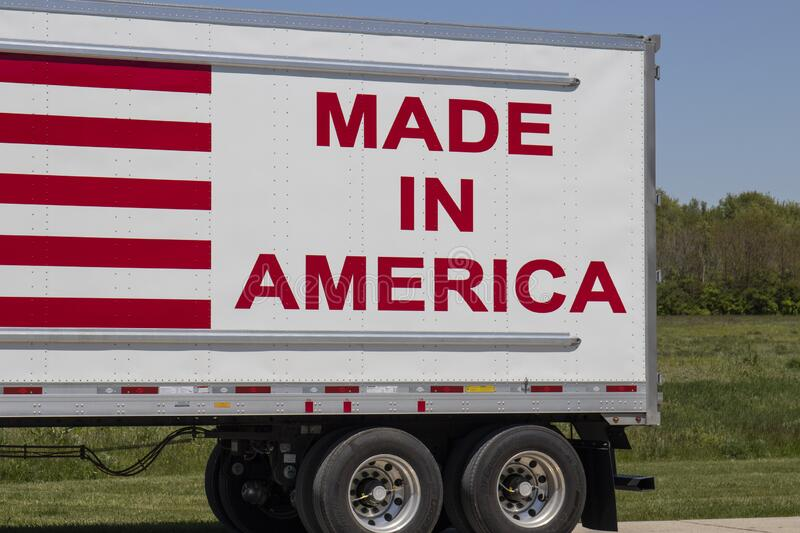 Big rig truck with the motto Made In America painted on the side with red letters and stripes. Terre Haute - Circa May 2020: Big rig truck with the motto Made In stock photography