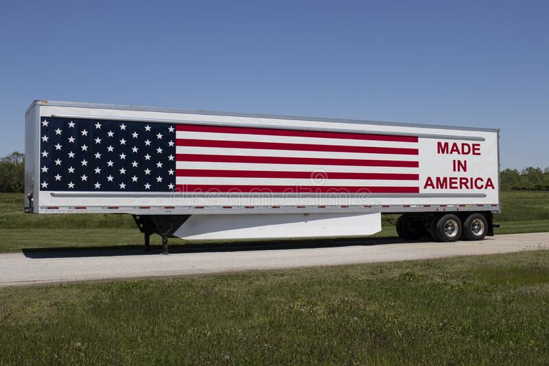 Big rig truck with the motto Made In America painted on the side with stars and stripes of the American flag. Terre Haute - Circa May 2020: Big rig truck with stock images