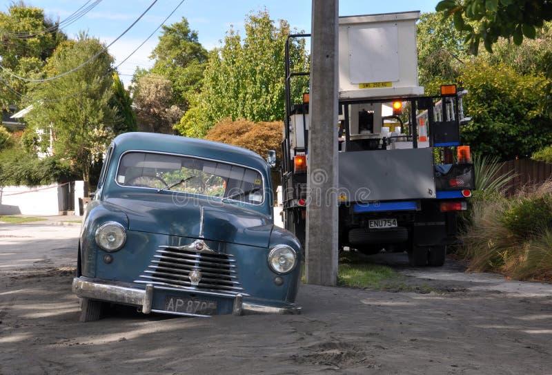 Terremoto de Christchurch - coche en la licuefacción imagen de archivo libre de regalías