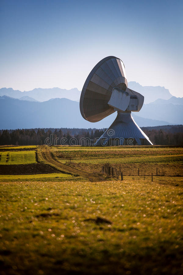 Terrestrial Antenna Raisting. A big terrestrial satellite antenna in front of mountains stock photography