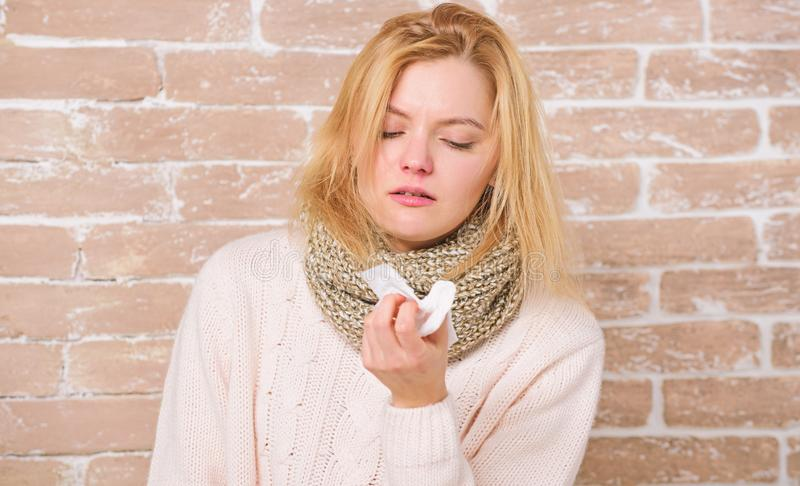 Terrible allergy. Cute woman caught nasal cold or allergic rhinitis. Sick woman blowing her nose in napkin. Pretty girl. Sneezing of seasonal influenza virus stock photos