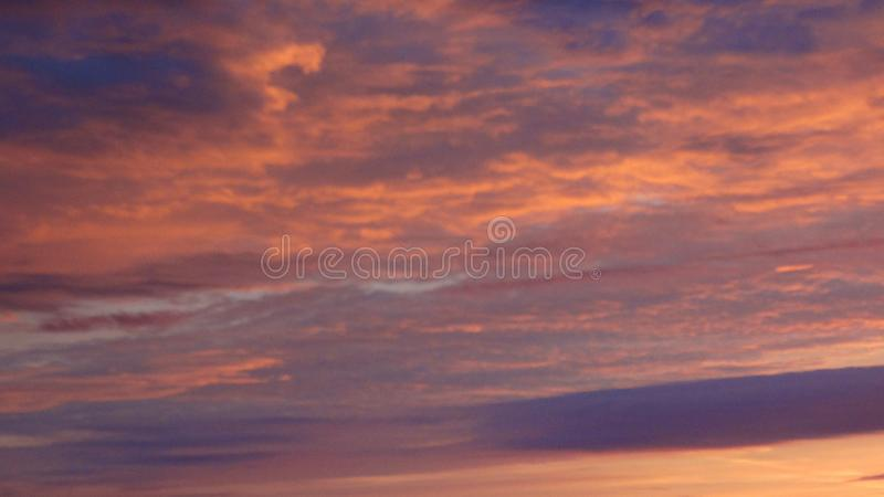 Terrible cumulus clouds at sunrise royalty free stock photo