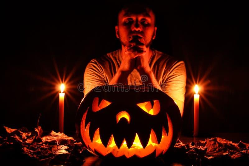 A terrible Halloween pumpkin glowing in the dark stock photos