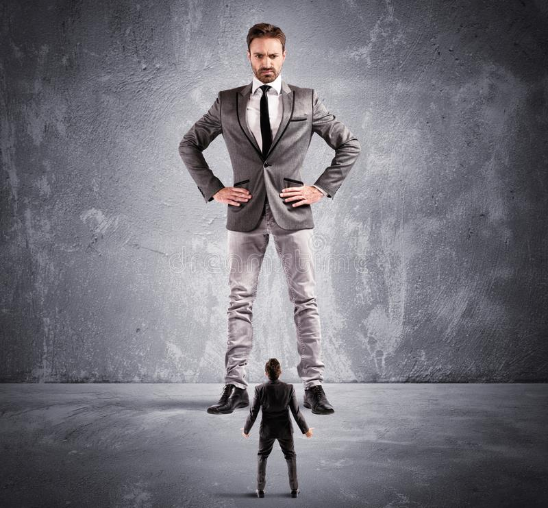 Terrified by the boss. Concept of authority abuse by the boss in a office stock photos