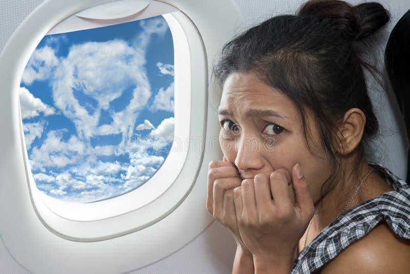Terrified passenger on a plane royalty free stock photo